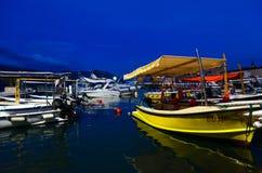 Pleasure boats and yachts at pier on promenade of Budva, Montenegro Stock Photos