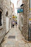 Budva. Narrow Street. BUDVA, MONTENEGRO - MAY 17, 2013: Two women walk through one of the narrow streets full of shops of the city of Budva, Montenegro. On May Royalty Free Stock Photos