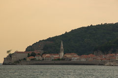 Budva's old town and the citadel, sunset. Budva, Montenegro. View from the sea to the old town of Budva stock images