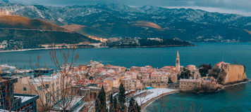 Budva`s Old Town in the snow, Montenegro. The coast is covered w Stock Photos