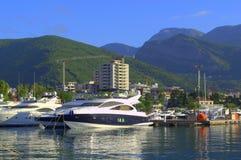 Budva town view,Montenegro. Luxury yachts anchored at the port and beautiful Budva town scenery,Montenegro stock photography