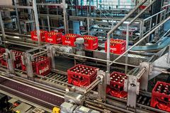 Budvar Budweiser brewery. Bottle sorting, washing and beer bottling workshop with assembly-lines. Royalty Free Stock Photo