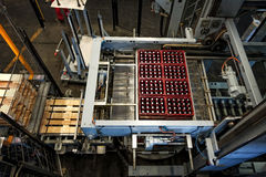 Budvar Budweiser brewery. Bottle sorting, washing and beer bottling workshop with assembly-lines. Stock Photos