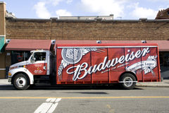 Budweiser delivery truck. A Budweiser delivery truck parked in front of a bar at the International district of Seattle. Budweiser is popular beer that is Royalty Free Stock Photography