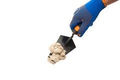 Budynek kielnia w męskiej ręce z budów rękawiczkami Obraz Royalty Free