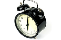 Budzik na bielu, pokazuje sześć o ` zegarów Fotografia Stock