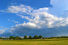 Bue Sky. Beautiful clouds at a soccer game royalty free stock photos