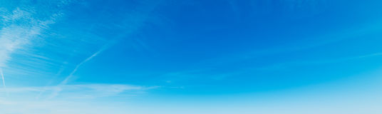 Bue sky and small clouds. Blue sky with white, soft clouds royalty free stock image