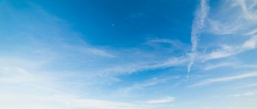 Bue sky in the springtime. Blue sky with white, soft clouds stock image