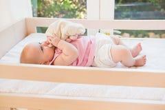 Bueatiful cute baby girl in her crib Royalty Free Stock Photos