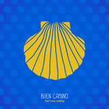 Buen Camino! Yellow shell on the blue background. Royalty Free Stock Photo