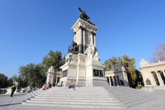 Buen Retiro, Madrid. MADRID, SPAIN - OCTOBER 23, 2012: People visit Monument to Alfonso XII in Madrid. The royal memorial located in Buen Retiro Park was Stock Images
