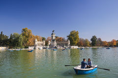 The Buen Retiro Park in Madrid, Spain. MADRID, SPAIN - NOVEMBER 14, 2015: Artifical lake and monument to Alfonso XII in the Buen Retiro Park, one of the main Royalty Free Stock Photo
