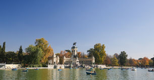 The Buen Retiro Park in Madrid, Spain. MADRID, SPAIN - NOVEMBER 14, 2015: Artificial lake and monument to Alfonso XII in the Buen Retiro Park, one of the main Royalty Free Stock Photo