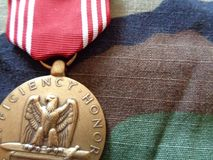 Buena medalla de conducta contra en BDU Fotos de archivo
