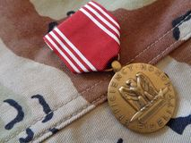 Buena medalla de conducta contra la DCU Foto de archivo