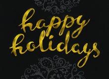 Buenas fiestas diseño de letras moderno elegante del cepillo del oro que brilla en un rastr negro del fondo Imagen de archivo libre de regalías