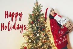 Buenas fiestas mande un SMS, los saludos de las estaciones, Feliz Navidad y happ Foto de archivo libre de regalías