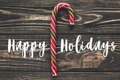 Buenas fiestas muestra del texto, tarjeta de felicitación la plano del caramelo de la Navidad Fotos de archivo libres de regalías