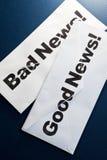 Buenas noticias y malas noticias Fotografía de archivo libre de regalías