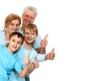 Buenos abuelos felices con los nietos engañados Imagen de archivo
