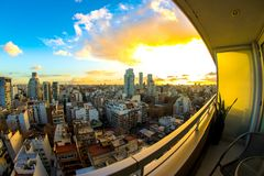 Buenos Aires panorama at dusk. BUENOS AIRES, ARGENTINA - CIRCA JULY 2017: View on the skyline of the city from a balcony of a high rise apartment circa July Royalty Free Stock Image