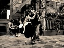 BUENOS AIRES , ARGENTINA. Couple dancing tango in the street ,April 10 2009 in Buenos Aires Argentina Royalty Free Stock Photos