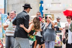 BUENOS AIRES, ARGENTINA - DECEMBER 25, 2017: Couple dancing tango on city street. With selective focus royalty free stock images