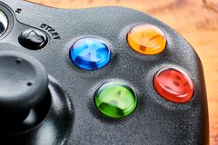 Closeup of XBOX 360 gamepad. BUENOS AIRES, ARGENTINA - FEBRUARY 16, 2018: Closeup of an XBOX 360 gamepad on table Royalty Free Stock Images