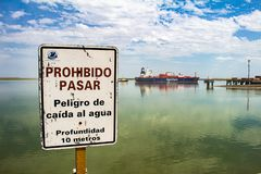 Buenos Aires. Argentina. February 3, 2018. Poster in the harbor of Bahía Blanca that indicates prohibited to pass and In the royalty free stock images