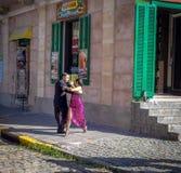 Tango dancers at La Boca neighborhood - Buenos Aires, Argentina royalty free stock images