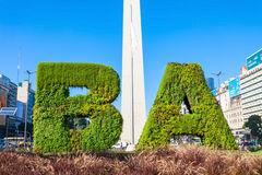 Buenos Aires sign and Obelisco. BUENOS AIRES, ARGENTINA - APRIL 14, 2016: Buenos Aires sign and Obelisco in Buenos Aires in Argentina. The Obelisk of Buenos royalty free stock image