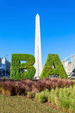 Buenos Aires sign and Obelisco. BUENOS AIRES, ARGENTINA - APRIL 14, 2016: Buenos Aires sign and Obelisco in Buenos Aires in Argentina. The Obelisk of Buenos royalty free stock photo