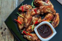 Bufalo style chicken wings. Hot chili sauce buffalo style chicken wings Stock Photos