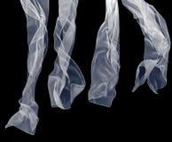 Bufanda blanca en un fondo negro Imagen de archivo libre de regalías