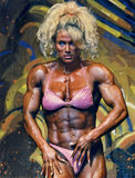 Buff Barbie Flex Appeal. Pro women's bodybuilder Melissa Coates, a Canadian,  displays her defined 6-pack abs and large and muscular delts, biceps and thighs at Stock Photo