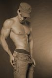 Buff guy with hat Royalty Free Stock Images