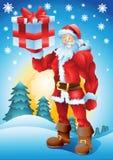 Buff Santa con el presente Imágenes de archivo libres de regalías