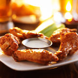 Buffalo barbecue hot chicken wings. Around ranch sauce with celery Stock Images