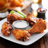Buffalo barbecue hot chicken wings. Around ranch sauce with celery Stock Image