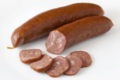 Buffalo (bison) bratwurst slices Royalty Free Stock Photography