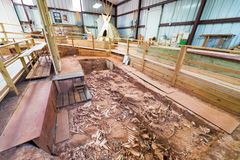 Buffalo Bones and Teepee. BEULAH, WY - AUGUST 26: Buffalo bones at the Vore Buffalo Jump archeology site on August 26, 2015 in Beulah, WY royalty free stock photography