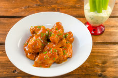 Buffalo chicken hot wings. With mayonnaise sauce and celery stock image