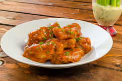 Buffalo chicken hot wings. With mayonnaise sauce and celery stock photography