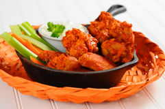 Buffalo Chicken Wings. Buffalo style chicken wings and fresh vegetables royalty free stock photography