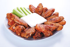 Buffalo chicken wings. On plate with blue cheese sauce and celery stock photography