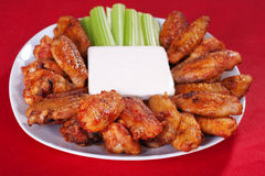 Buffalo chicken wings. On plate with blue cheese sauce and celery royalty free stock image