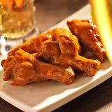 Buffalo chicken wings with beer royalty free stock image