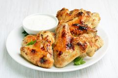 Buffalo chicken wings. On white plate, close up royalty free stock image