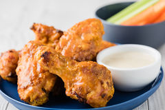 Buffalo chicken wings with celery carrot sticks Stock Photo